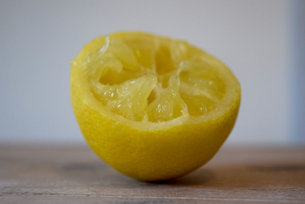 a close up of a squeezed lemon half