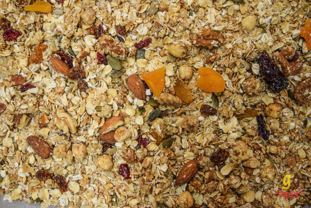 granola consisting of oats, nuts, seeds, dried fruit