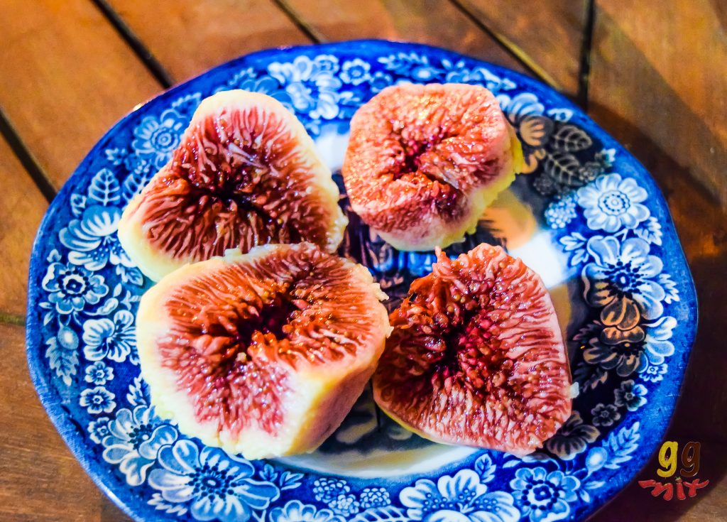 A PLATE OF FIGS - SYKA CUT IN HALF