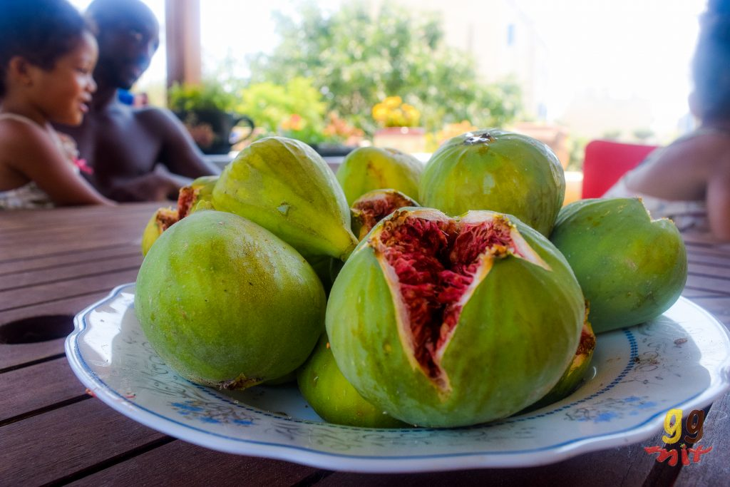 A PLATE OF GREEN FIGS - SYKA AND ONE HAS BURST OPEN