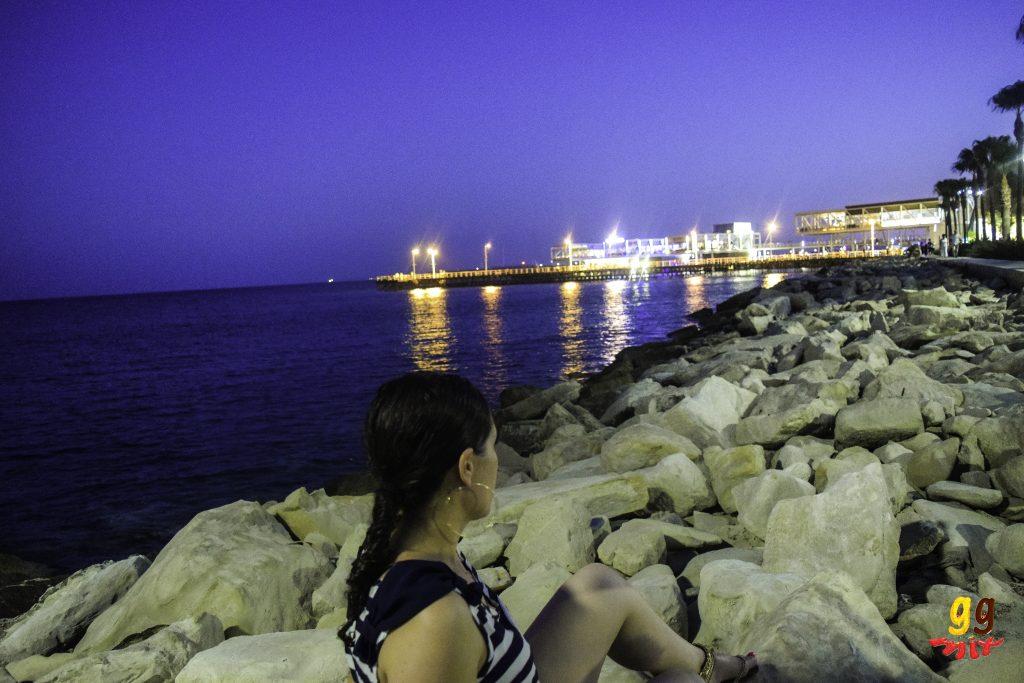 A VIEW OF THE MARINA AND SEA AT MOLOS - PROMENADE LIMASSOL CYPRUS AT NIGHT