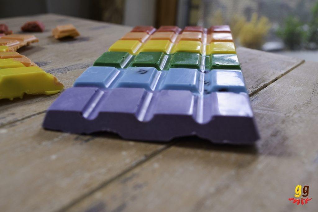 a rectangular rainbow chocolate bars coloured red, orange, yellow, green, blue and purple