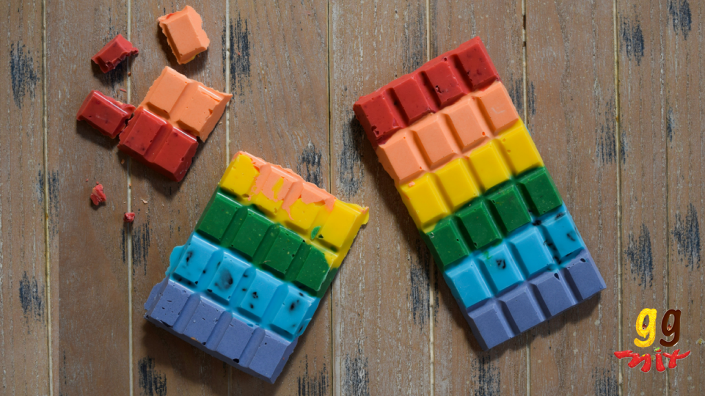 two rectangular rainbow chocolate bars coloured red, orange, yellow, green, blue and purple