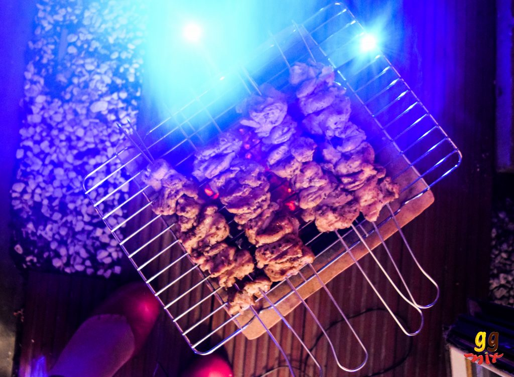Greek Cypriot pork souvlaki cooing on the BBQ