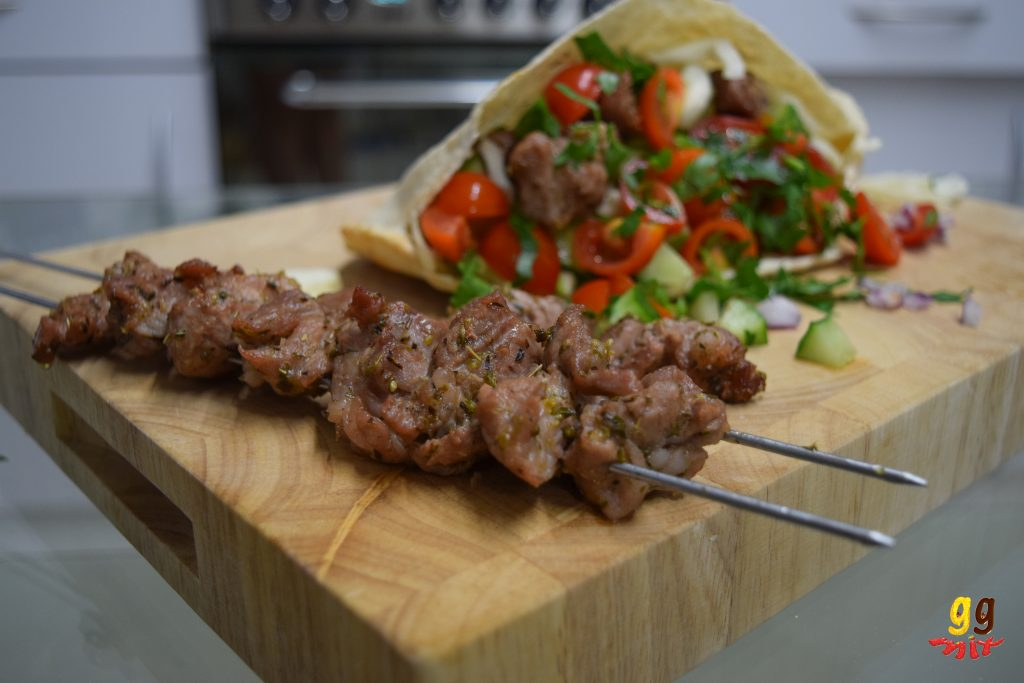 Greek pork souvlaki in a pitta with salad