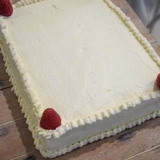 FRESH CREAM LAYERED VANILLA SHEET CAKE WITH RASPBERRIES & BLUEBERRIES