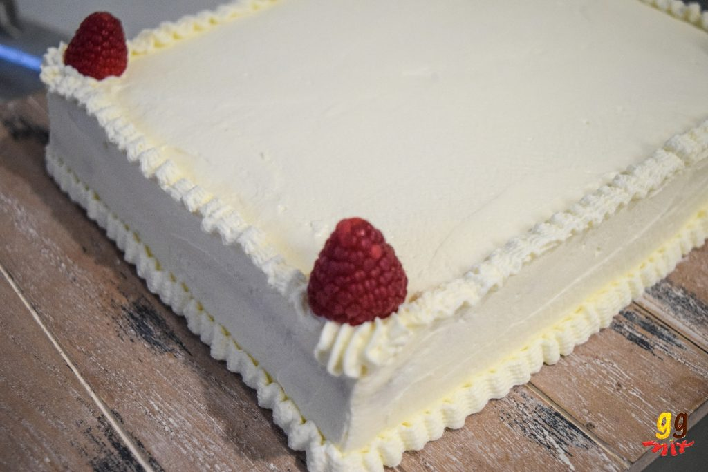 A fresh cream cake with fresh fruit