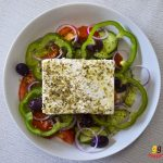 Greek Cypriot village salad with feta cheese, kalmata olives, green bell peppers, red onions, tomatoes and cucumbers