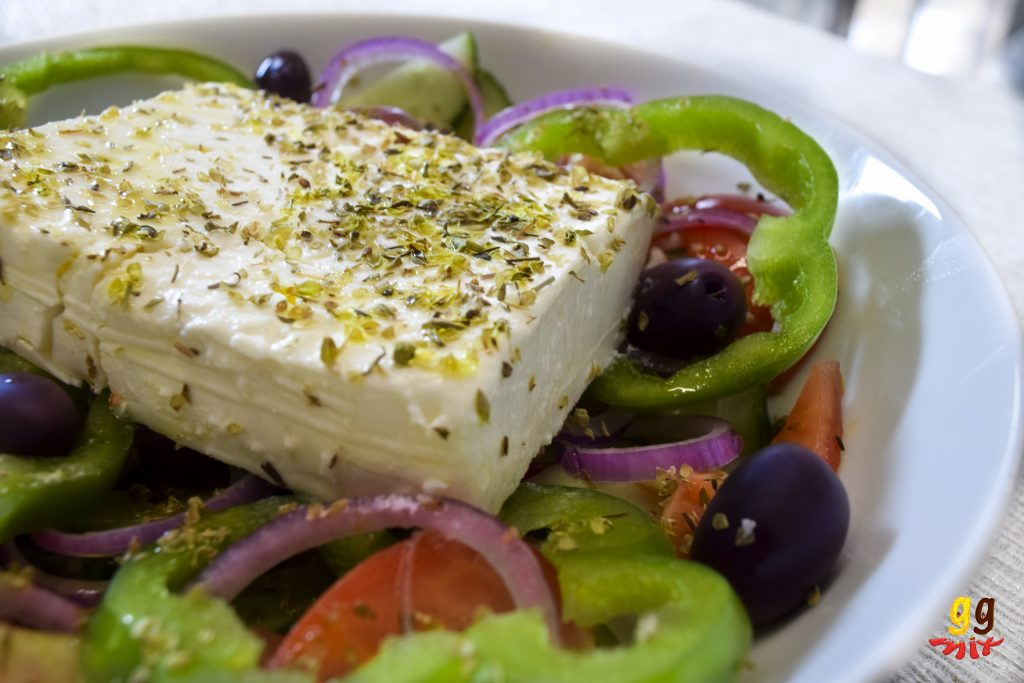Greek Cypriot village horiatiki salad salata with feta cheese, kalamata olives, green bell peppers, red onions, tomatoes and cucumbers