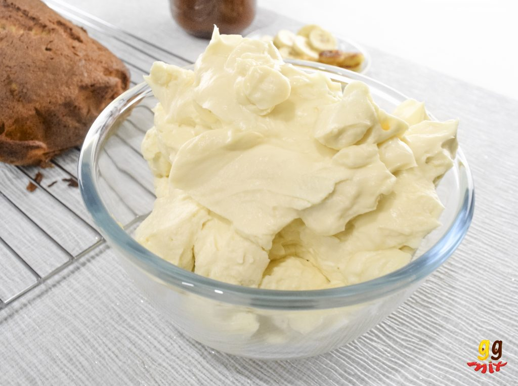 a bowl of golden cream cheese frosting