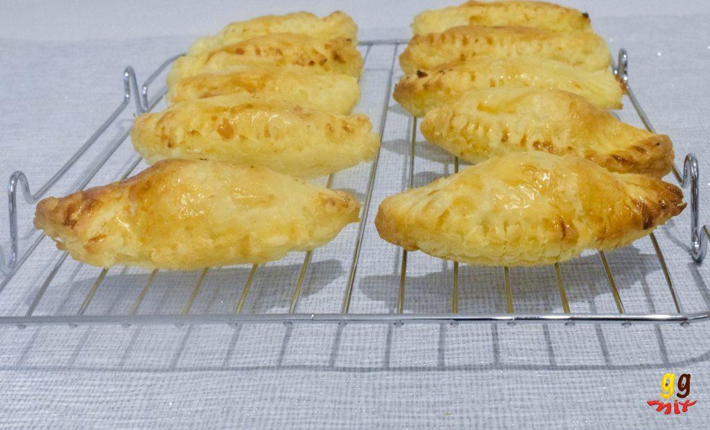 bougatsa greek semolina custard filled hand pies cooling on a wire rack