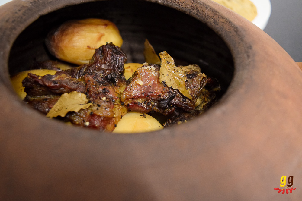 kleftiko slow cooked lamb and potatoes and bay leaves in a traditional Greek clay pot