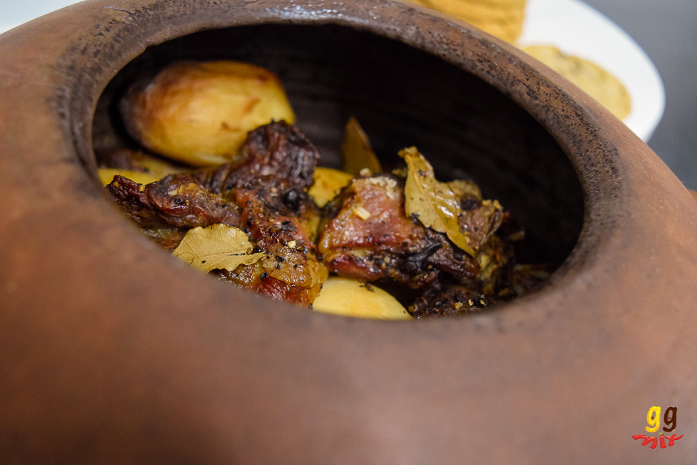 kleftiko slow cooked lamb and potatoes and bay leaves in a traditional Greek kleftiko clay pot