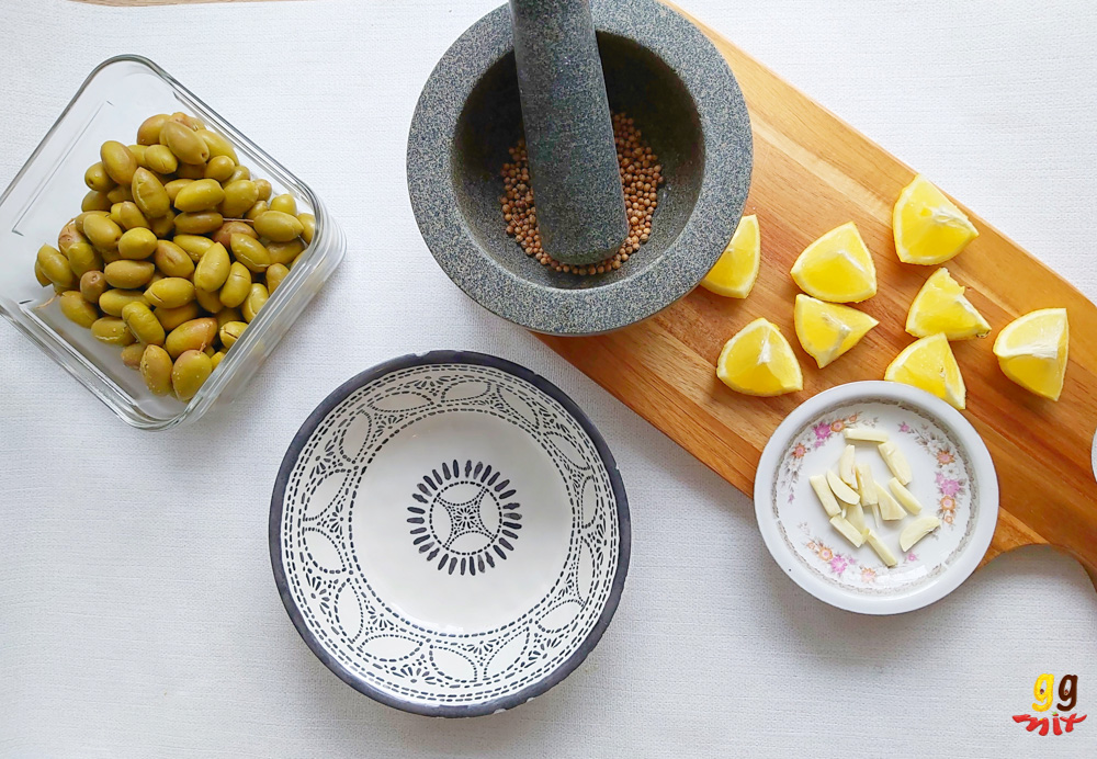 INGREDIENTS FOR ELIES TSAKISTES GREEK CRACKED GREEN OLIVES B