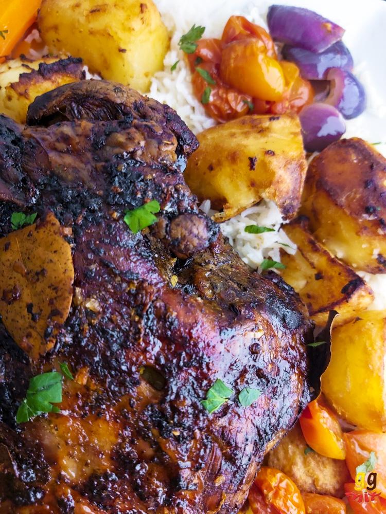 Lemon and honey roasted leg of lamb with crispy potatoes, my 30 minutes lemoniest lemon rice, orange honey glazed carrots, roasted tomatoes and onions.