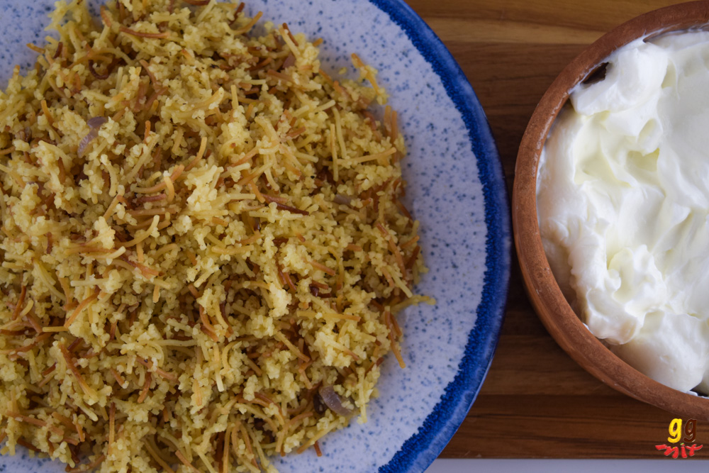 a plate of Greek Cypriot pourgouri and a bowl of Greek yogurt on the side