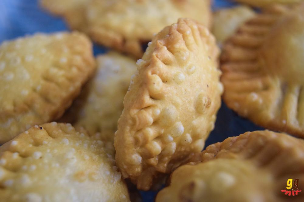 round bourekia me anari small hand pies draining on kitchen paper