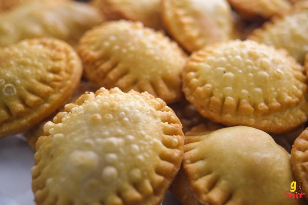round bourekia me anari small hand pies sugar on a platter